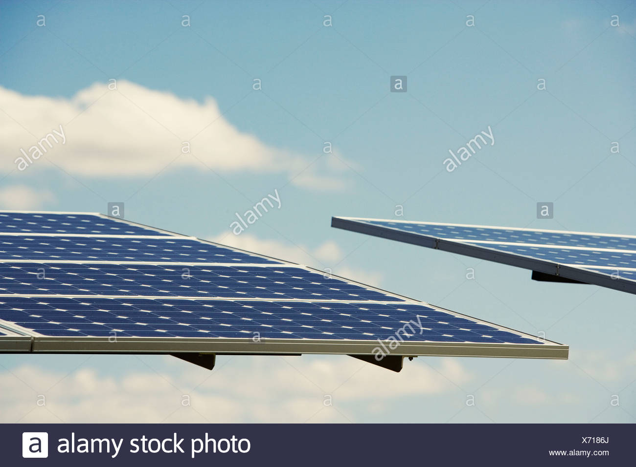 Photovoltaic panels tilted to sun - Stock Image