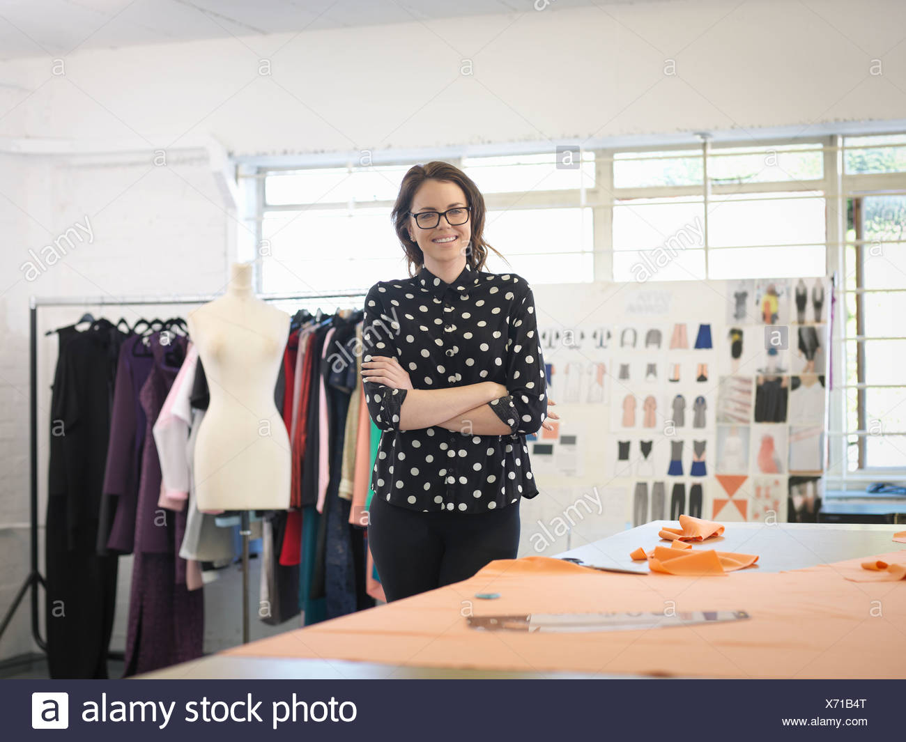 Fashion designer in fashion design studio, portrait - Stock Image