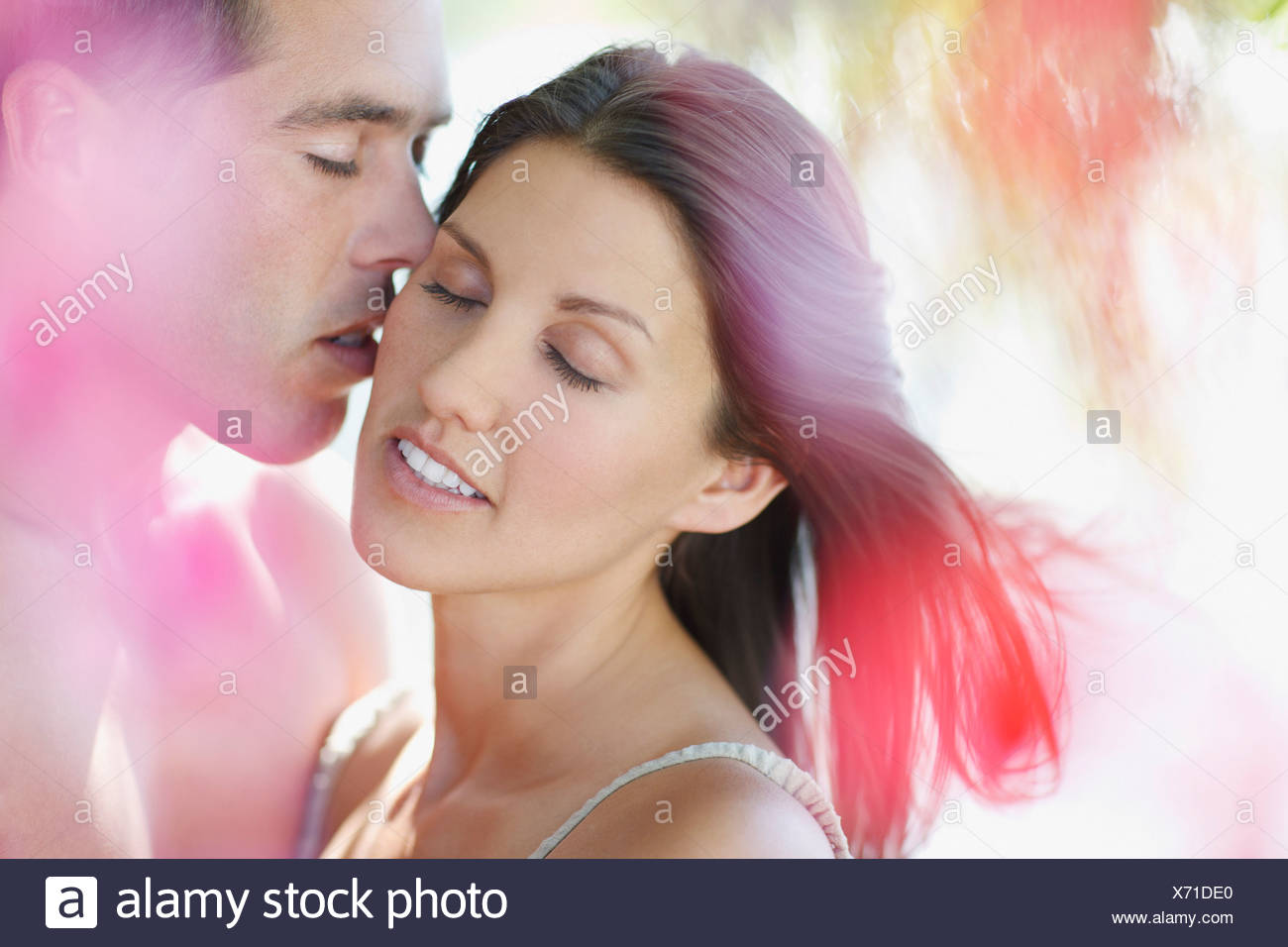 Husband kissing wife - Stock Image