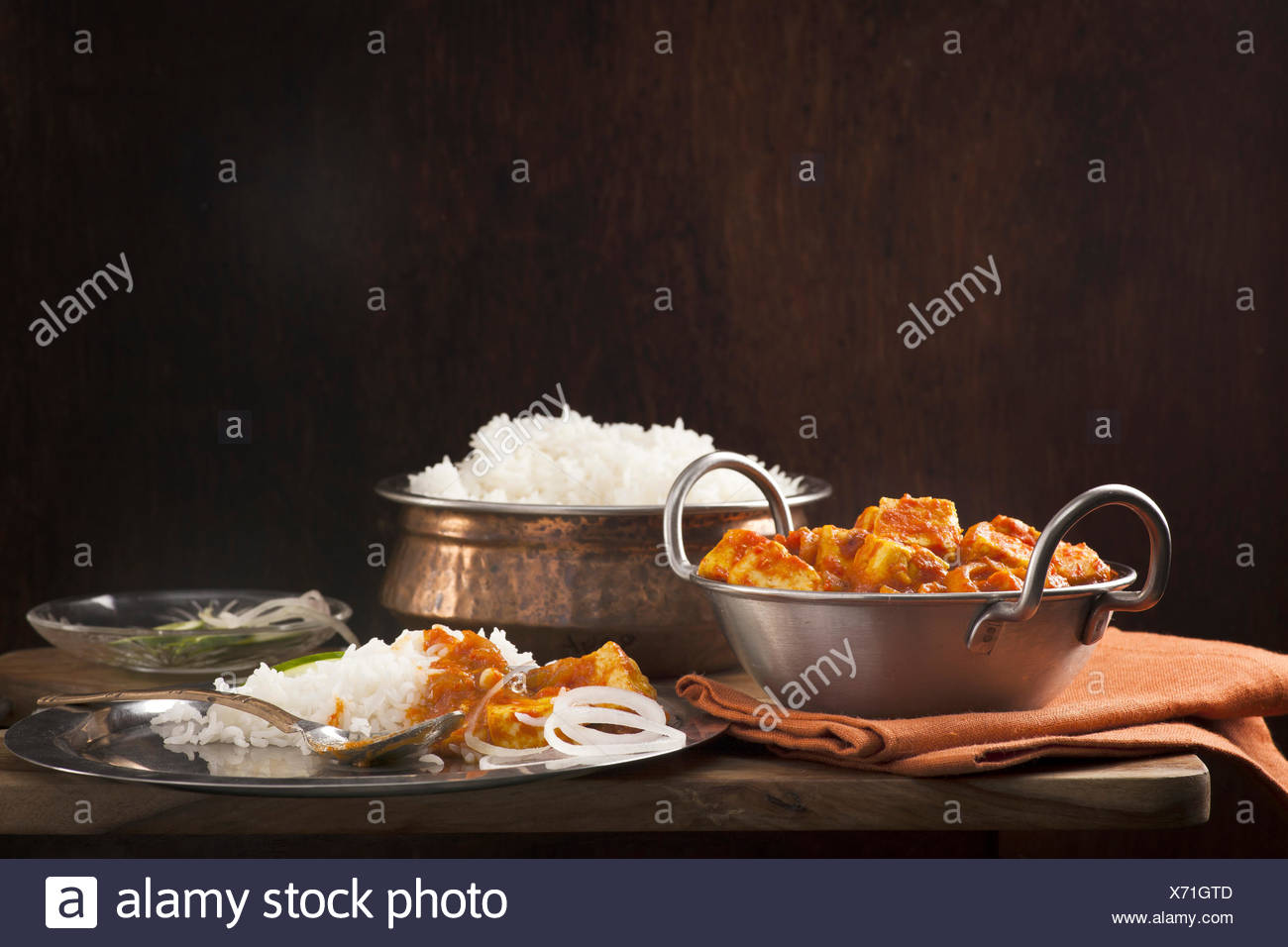 Paneer and sweet pepper curry with rice on wooden background Stock Photo