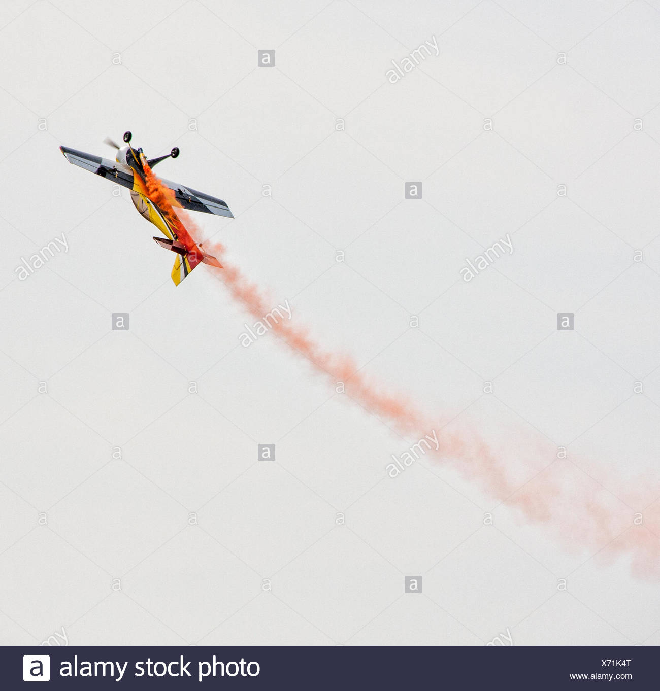 Low angle view of performing stunt plane - Stock Image