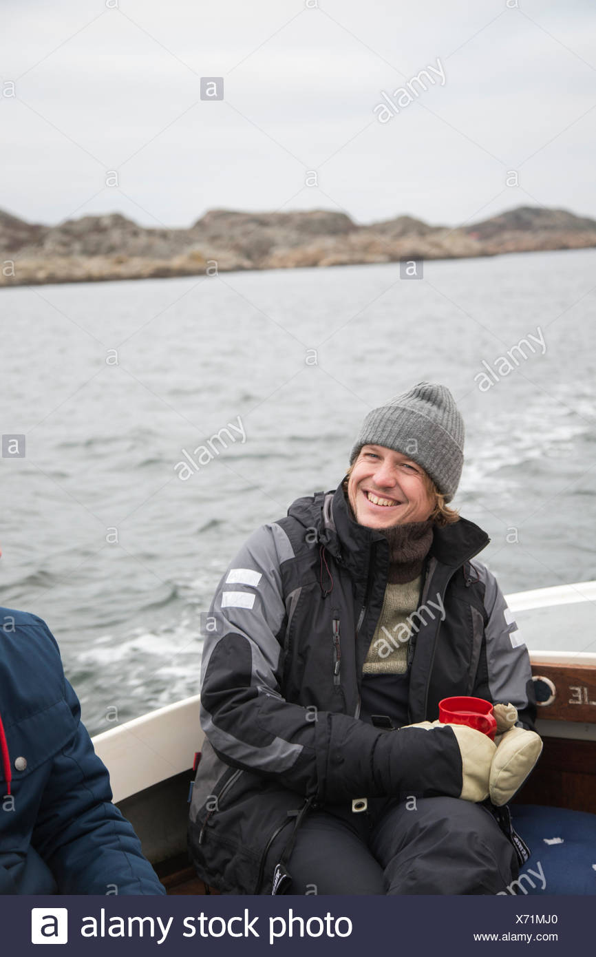 Sweden, Bohuslan, Marstrand, Portrait of mature man on motor boat - Stock Image