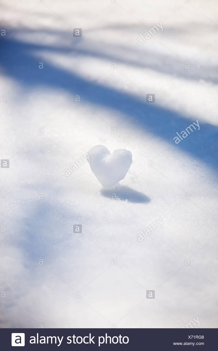 Heart-shape snowball - Stock Image