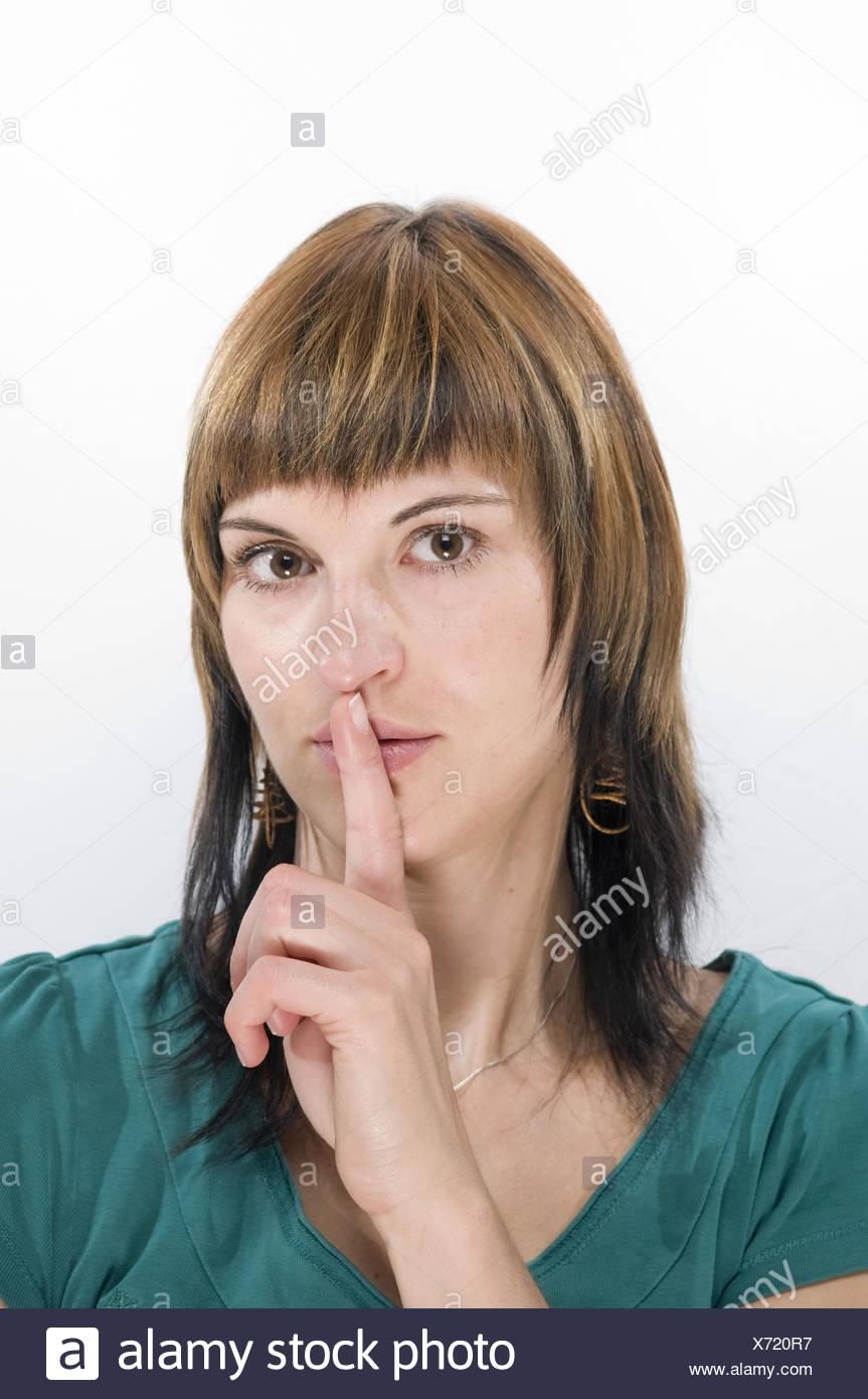 finger on lips left - Stock Image