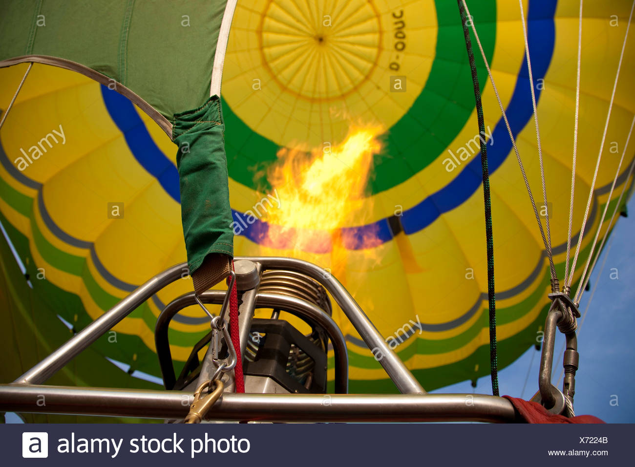 view into the envelope of a hot-air balloon, with the flame of the burner - Stock Image