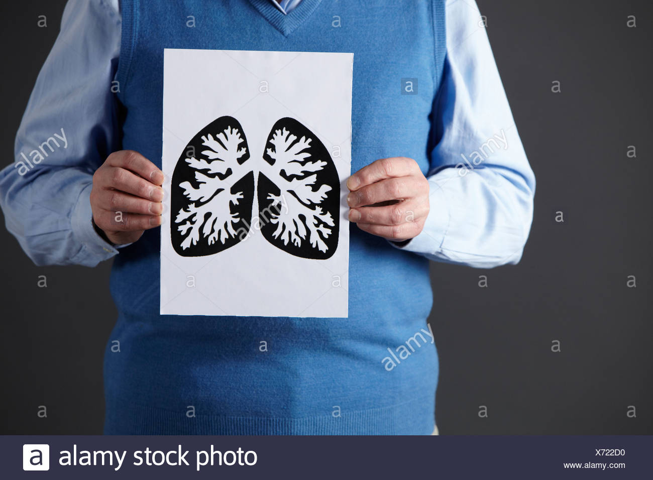 Senior man holding ink drawing of lungs - Stock Image