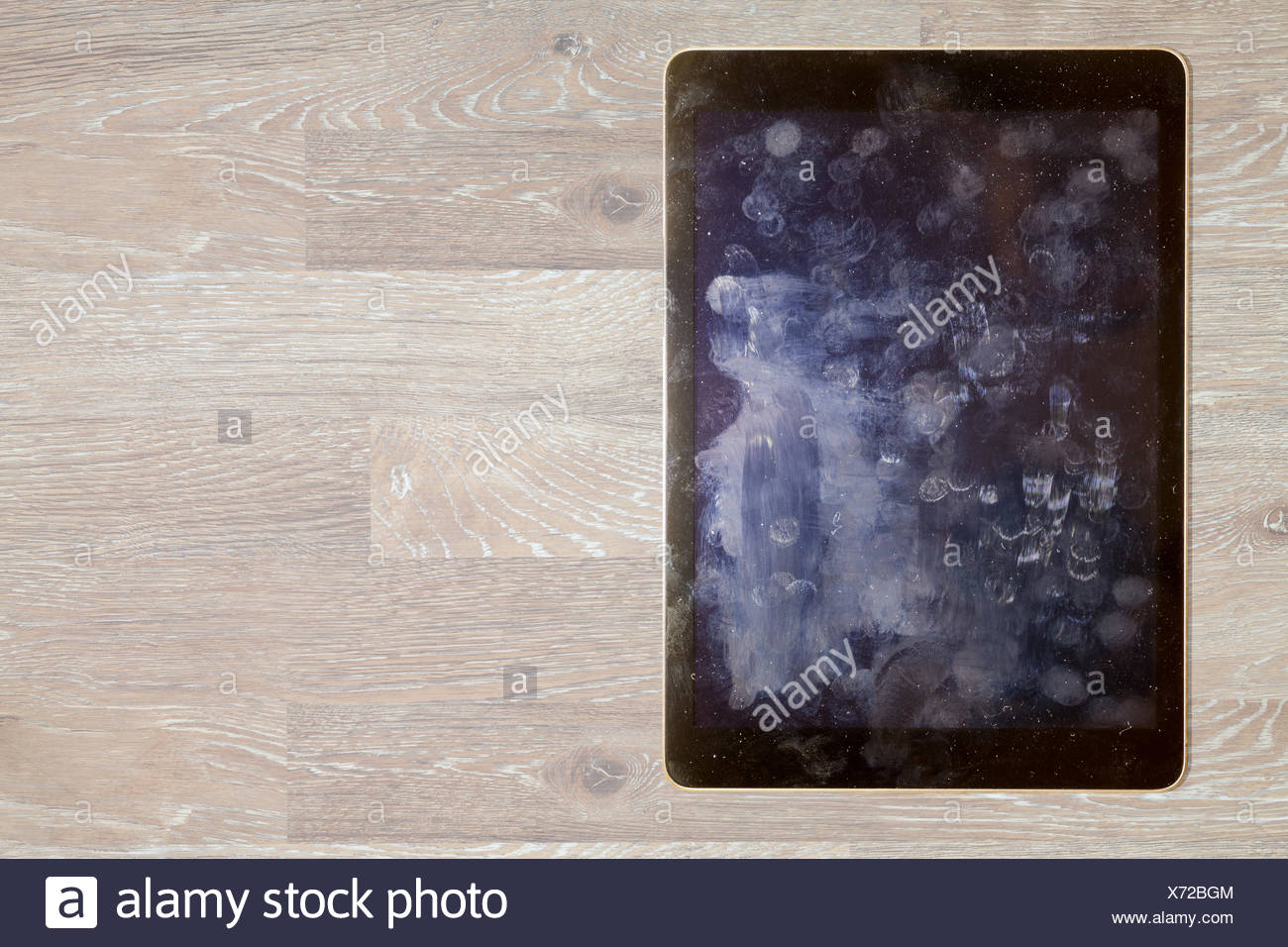 View of fingerprints and grease on tablet screen - Stock Image