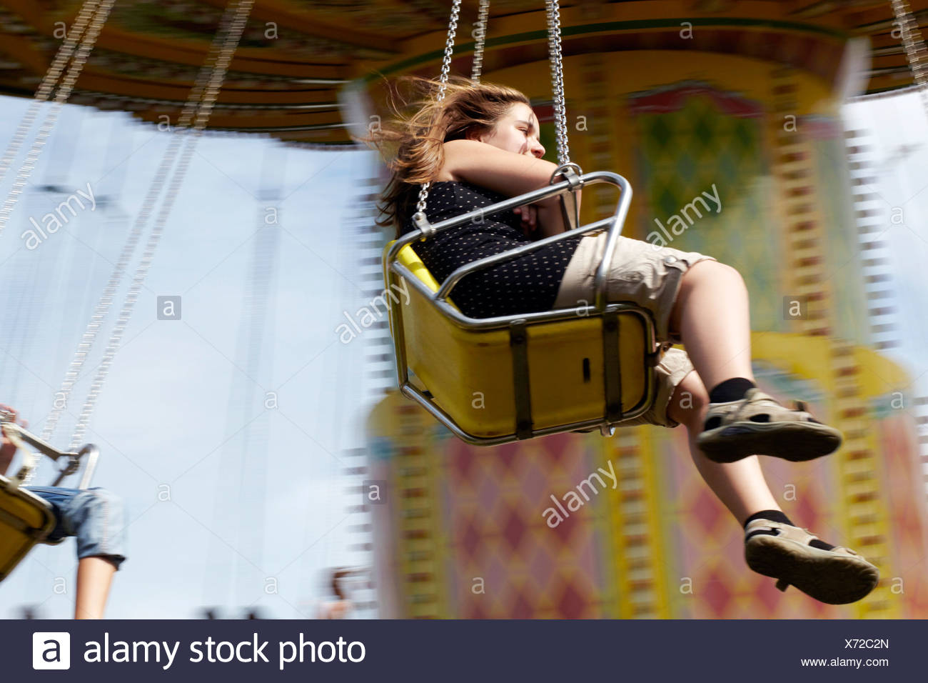 People Sitting in Amusement Park Ride, Bad Woerishofen, Bavaria, Germany, Europe - Stock Image