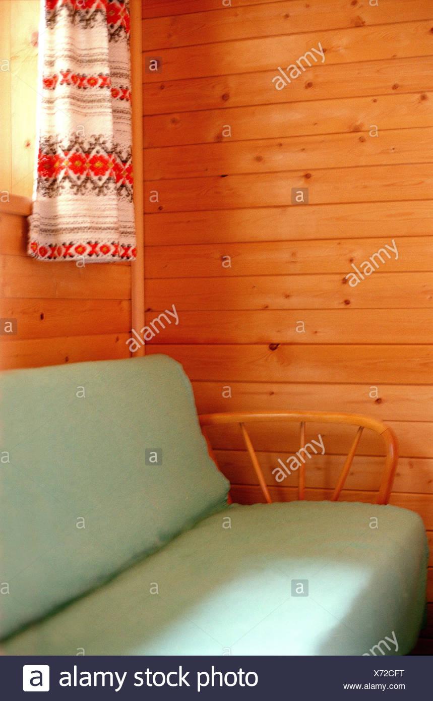 Holzvertäfelung ski hut living space sofa detail cottage housing mountain hut