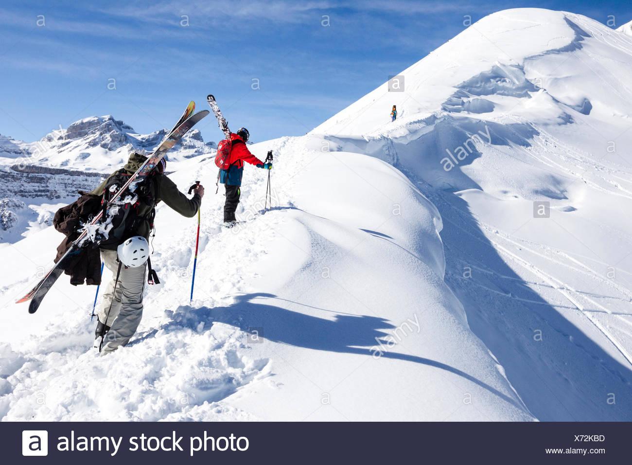 Two skiers ascending in deep snow, freeride skiing area Haldigrat, Niederrickenbach, Oberdorf, Canton of Nidwalden, Switzerland - Stock Image
