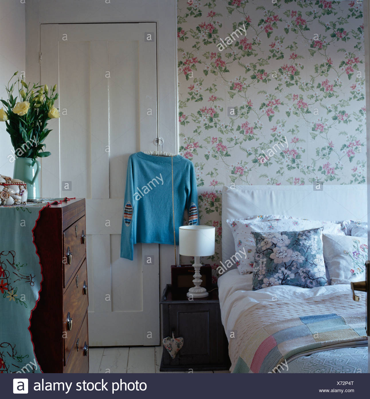 Floral Wallpaper In Country Bedroom With Blue White Cushions On