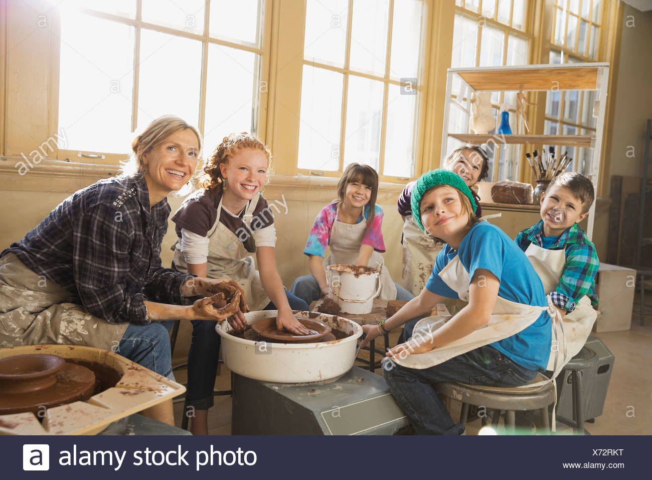 Teacher and students in pottery class Stock Photo