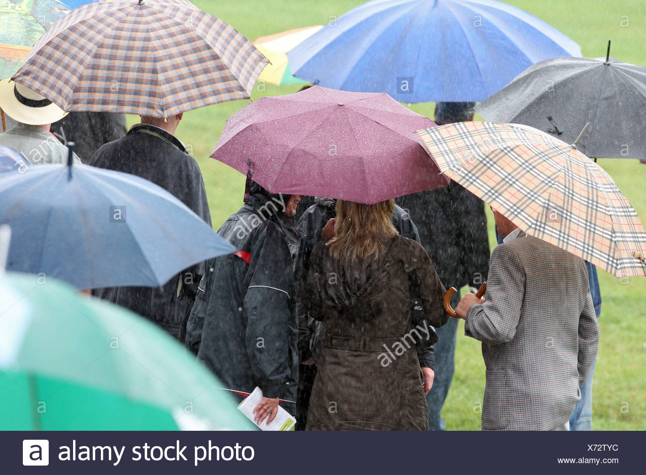 Duesseldorf, Germany, people are in bad weather under their umbrellas - Stock Image
