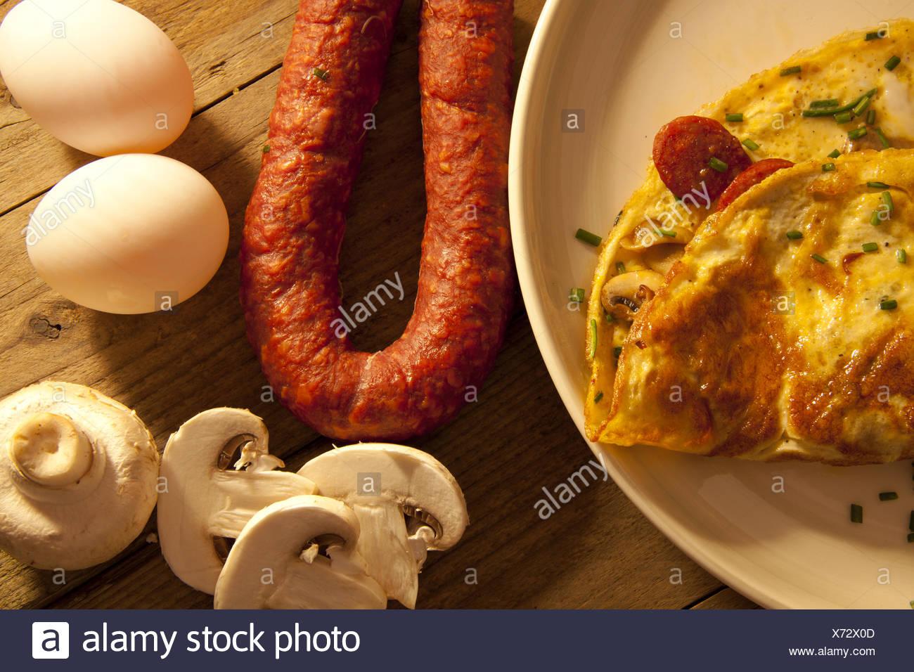 Freshly prepared omelette. - Stock Image