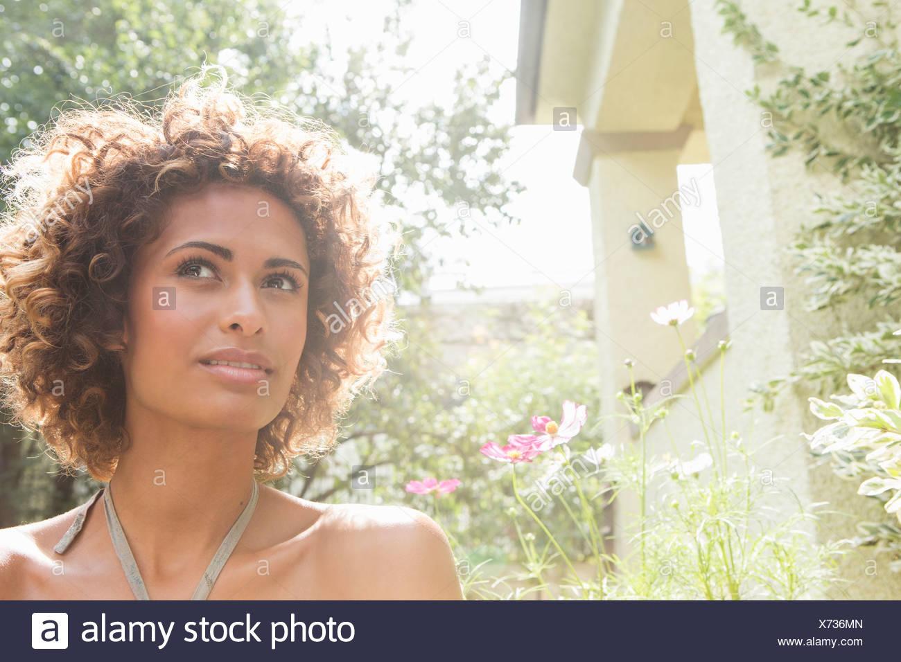 Woman walking in garden - Stock Image