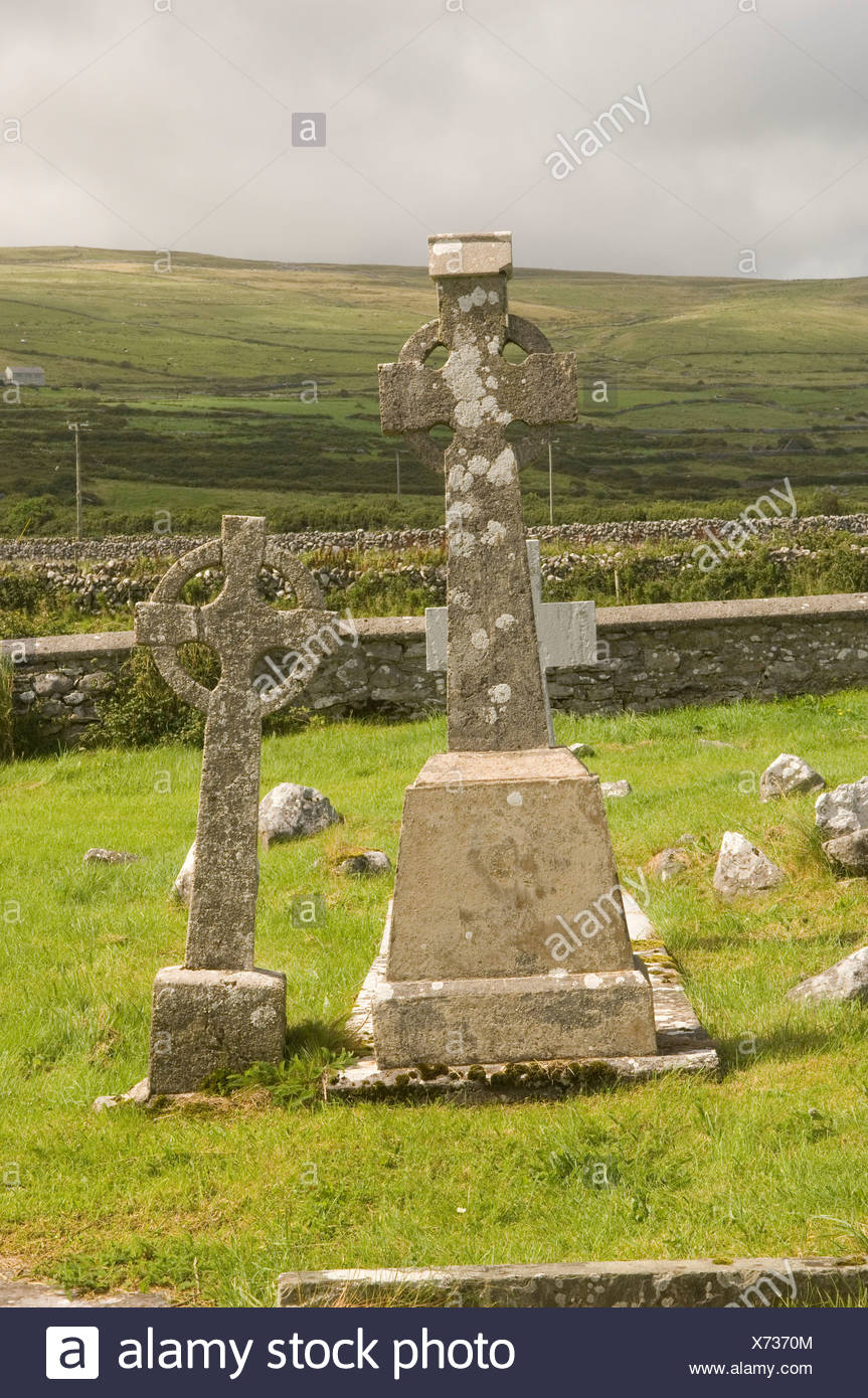Republic of Ireland, Fanore, The Burren, Celtic crosses in cemetery - Stock Image