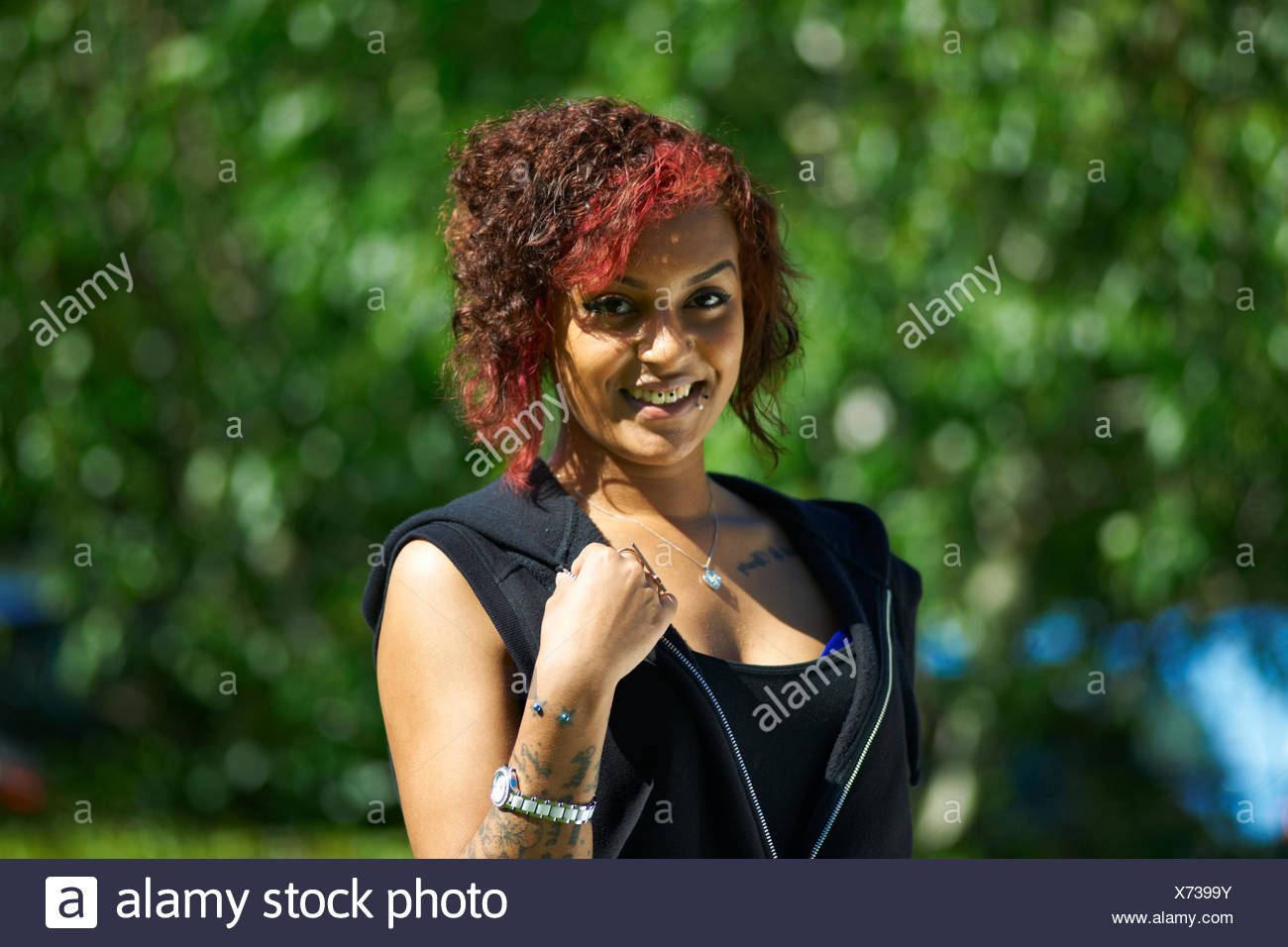 Portrait of young female student outside college - Stock Image