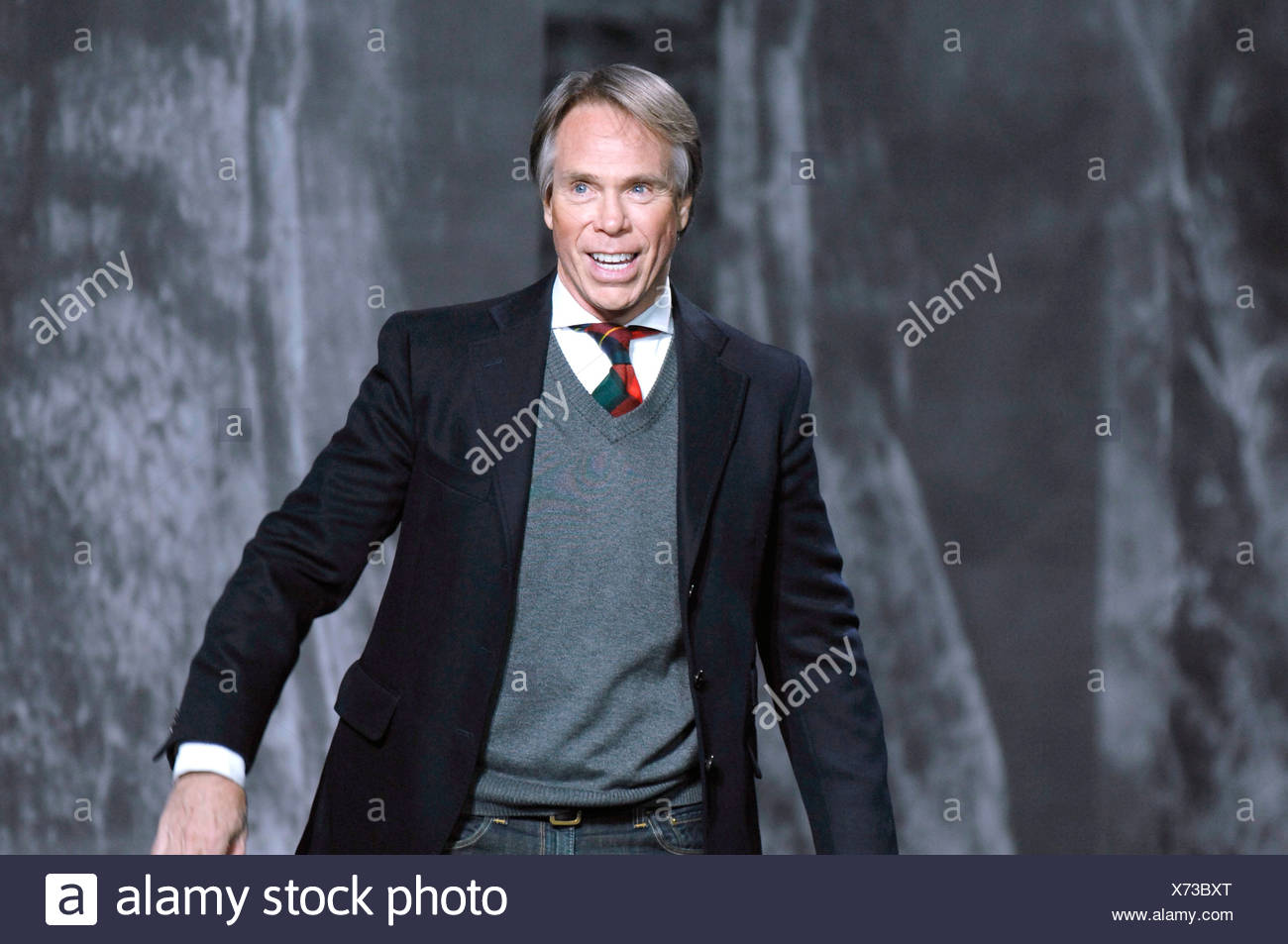 a70d4a42 Tommy Hilfiger New York Ready to Wear Autumn Winter Designer Tommy Hilfiger  wearing shirt and tie and grey v neck jumper under