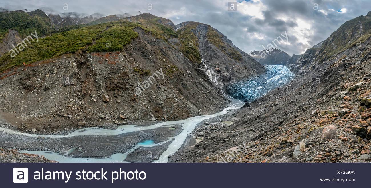 Glacier tongue with glacial river, Franz Josef Glacier, West Coast, Southland, New Zealand - Stock Image