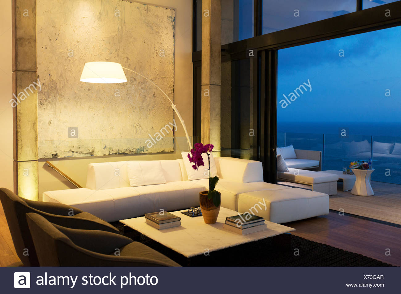 Lamp and sofa in modern living room - Stock Image