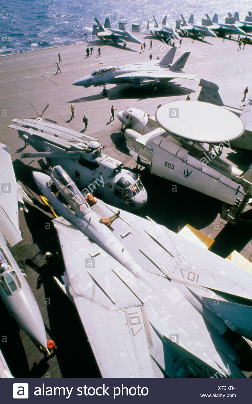 High angle view military aircraft on an aircraft carrier in Red Sea during Operation Desert Storm F-14A Tomcat E-2C Hawkeye - Stock Image