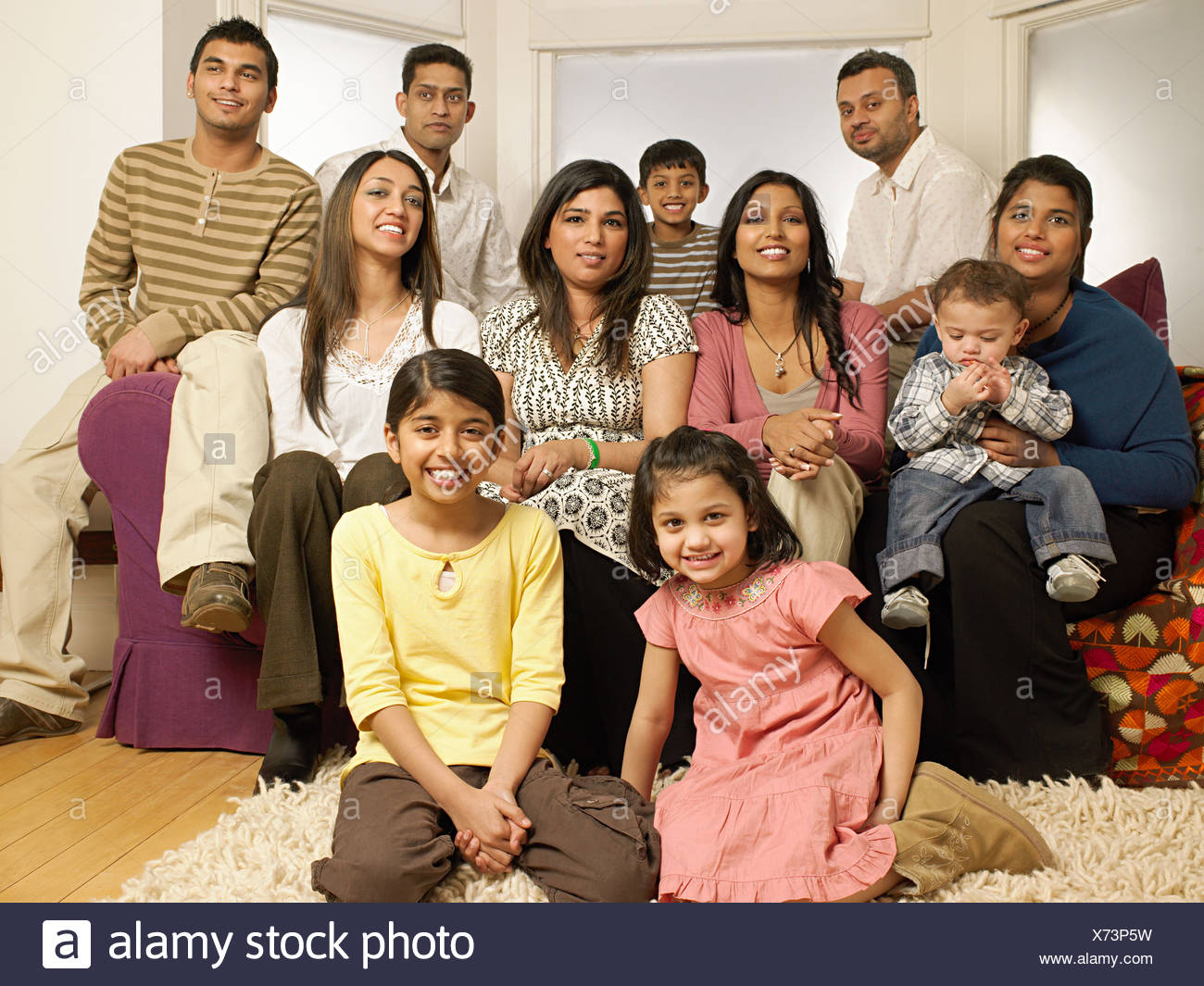 Large indian family in living room - Stock Image