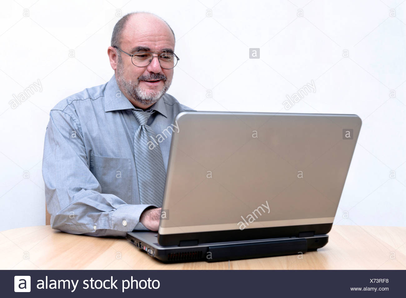 Man focussed on his work on the laptop Stock Photo