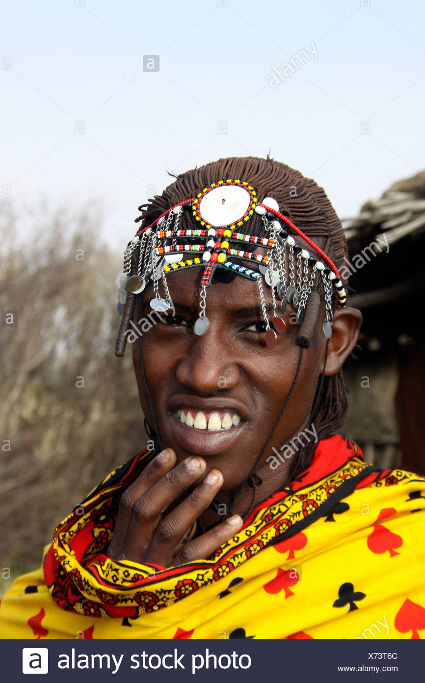 Kenya, Masai Mara, Masai (Also Maasai) Tribesmen an ethnic group of semi-nomadic people. Warriors with traditional headdress - Stock Image