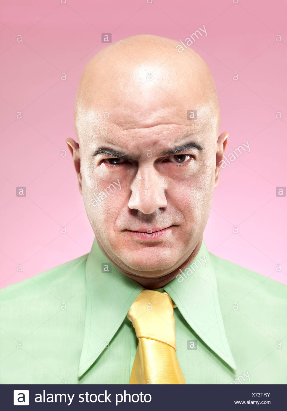 Bald man frowning - Stock Image