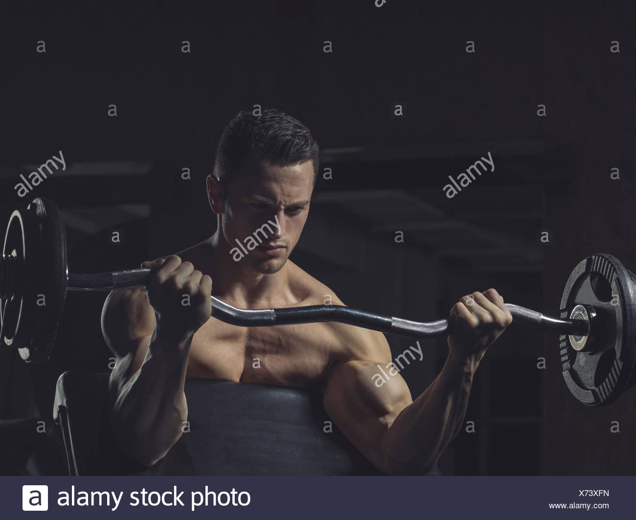 Athlete with bicepscurl, training of biceps - Stock Image