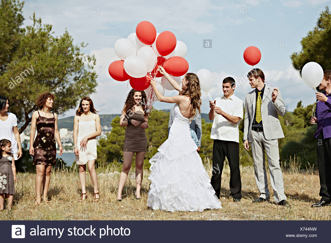 Wedding Guests With Balloons Outdoors, Croatia, Europe - Stock Image