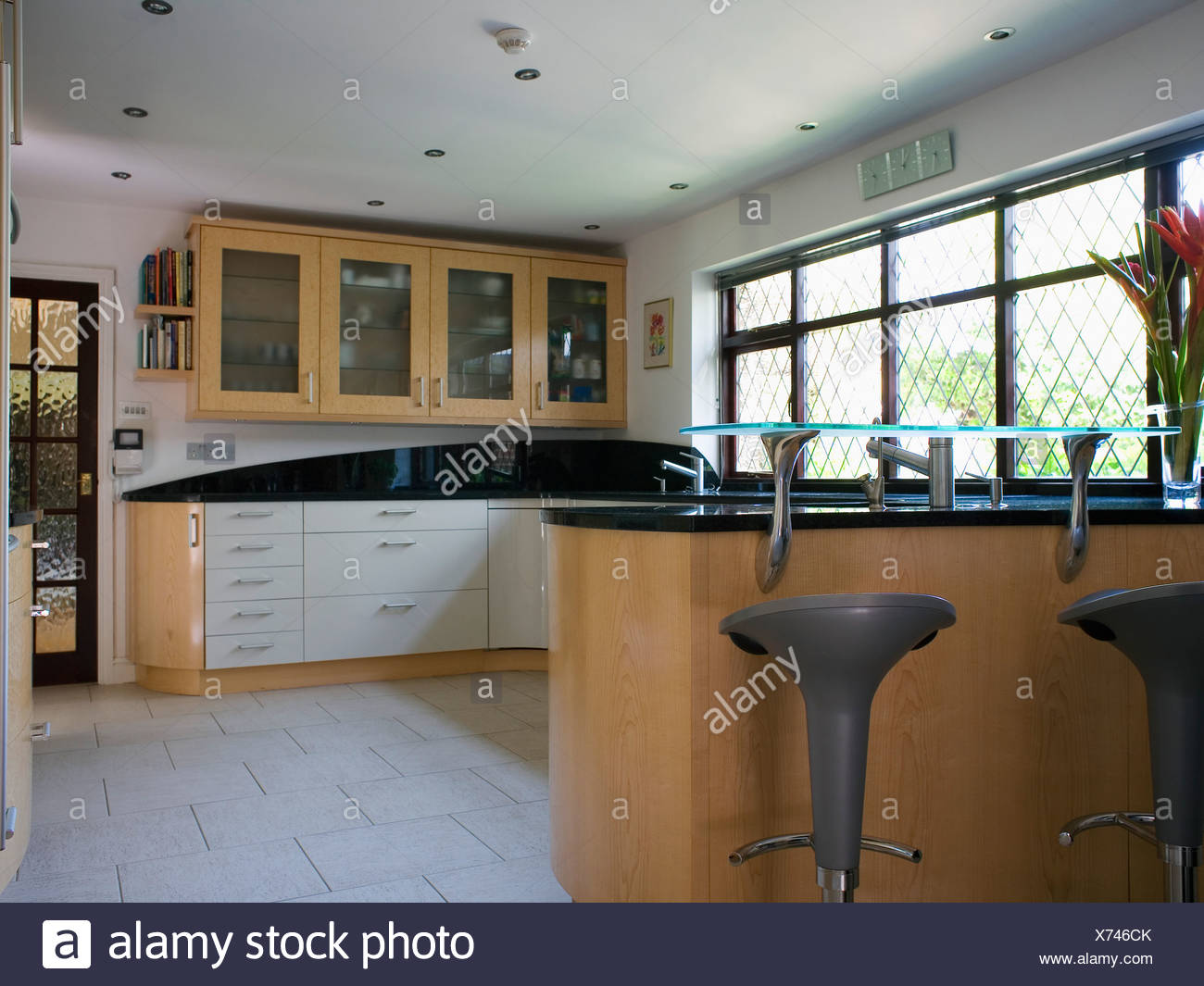 Cream ceramic floor tiles in modern country kitchen with ...