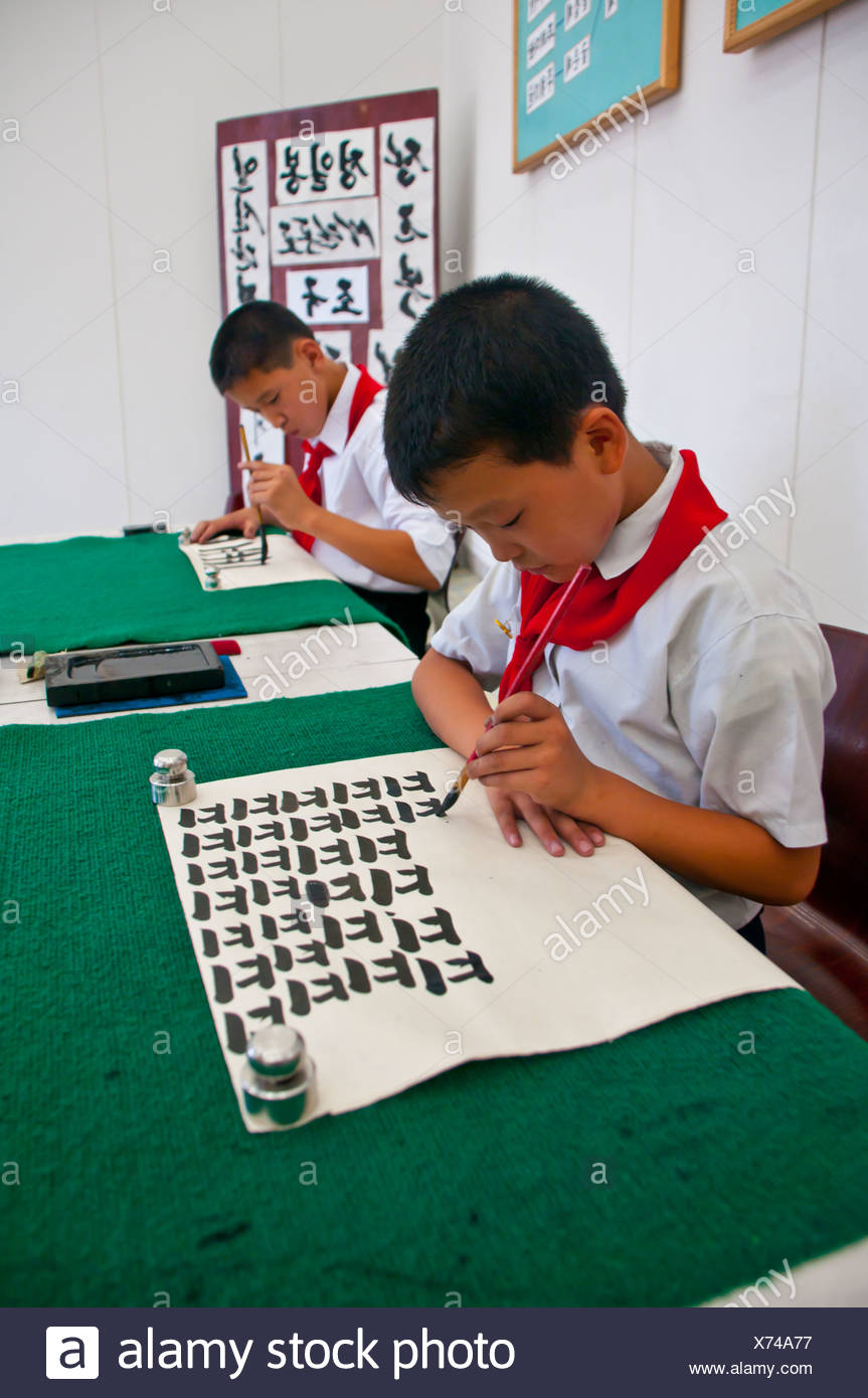 Selected children practicing calligraphy in the Children's Palace, Pyongyang, North Korea, Asia - Stock Image