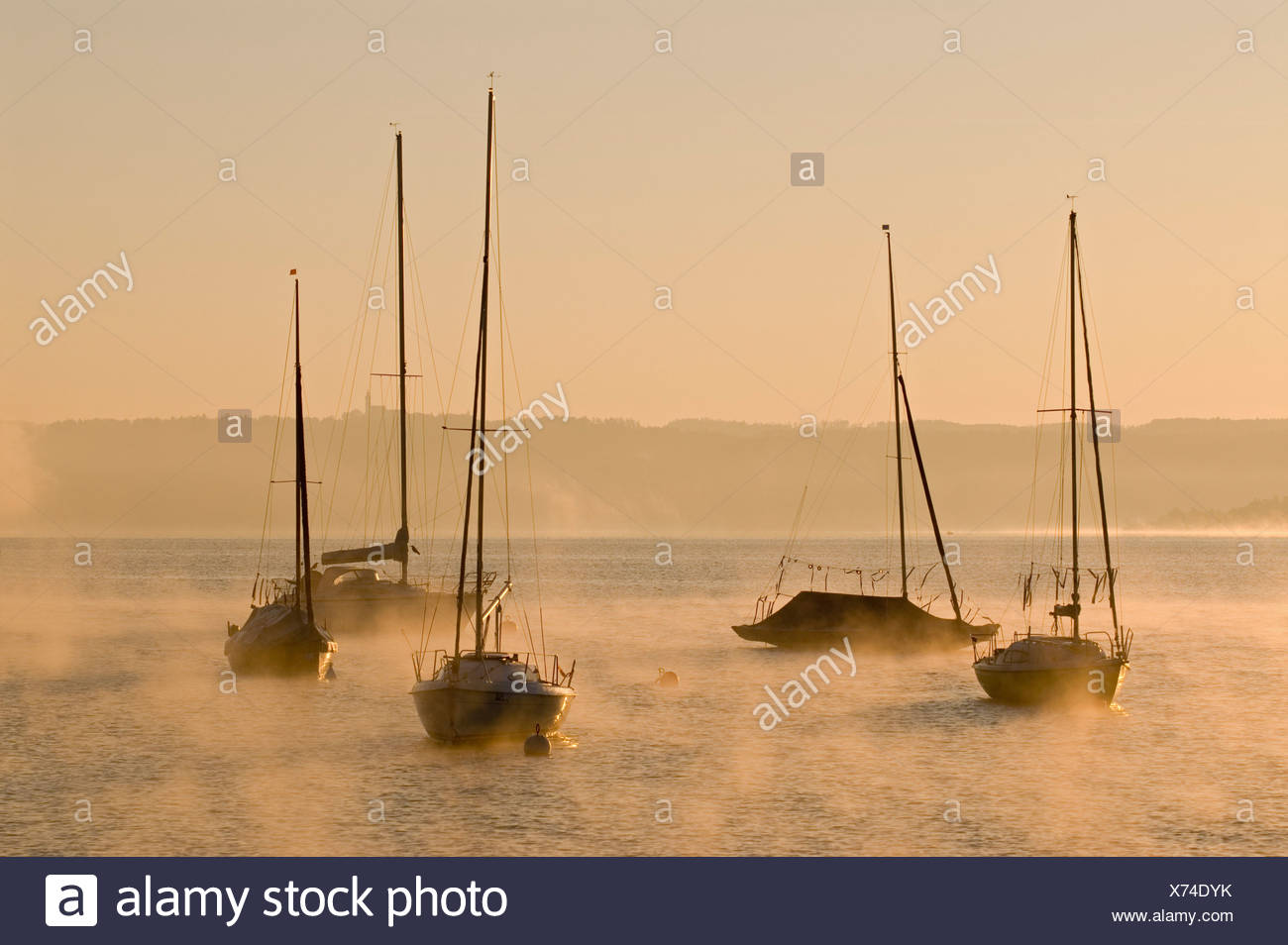 Sailing boats and low morning fog over Ammersee lake at Utting, Bavaria, Germany, Europe Stock Photo