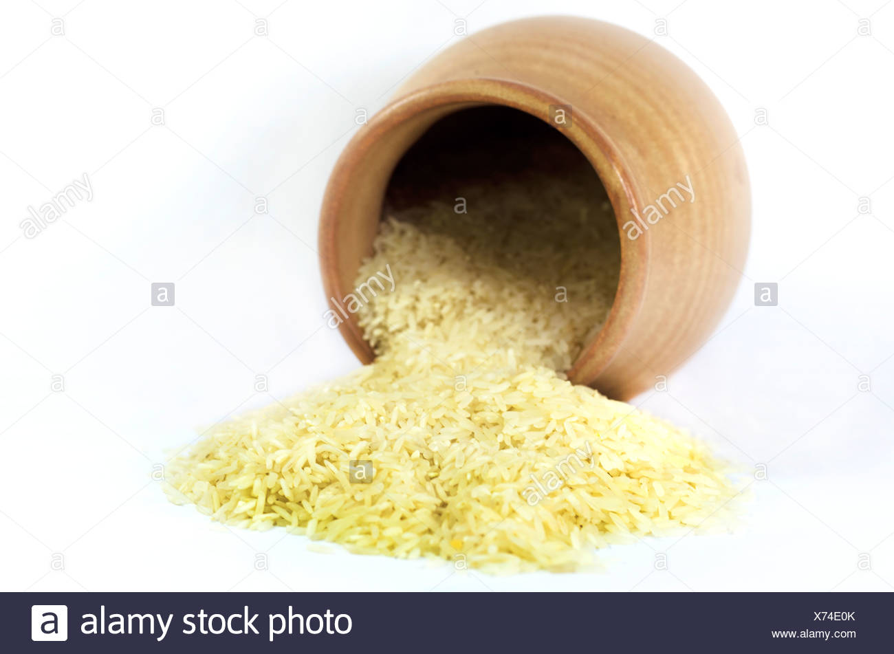 rice  in an earthenware pot. Stock Photo