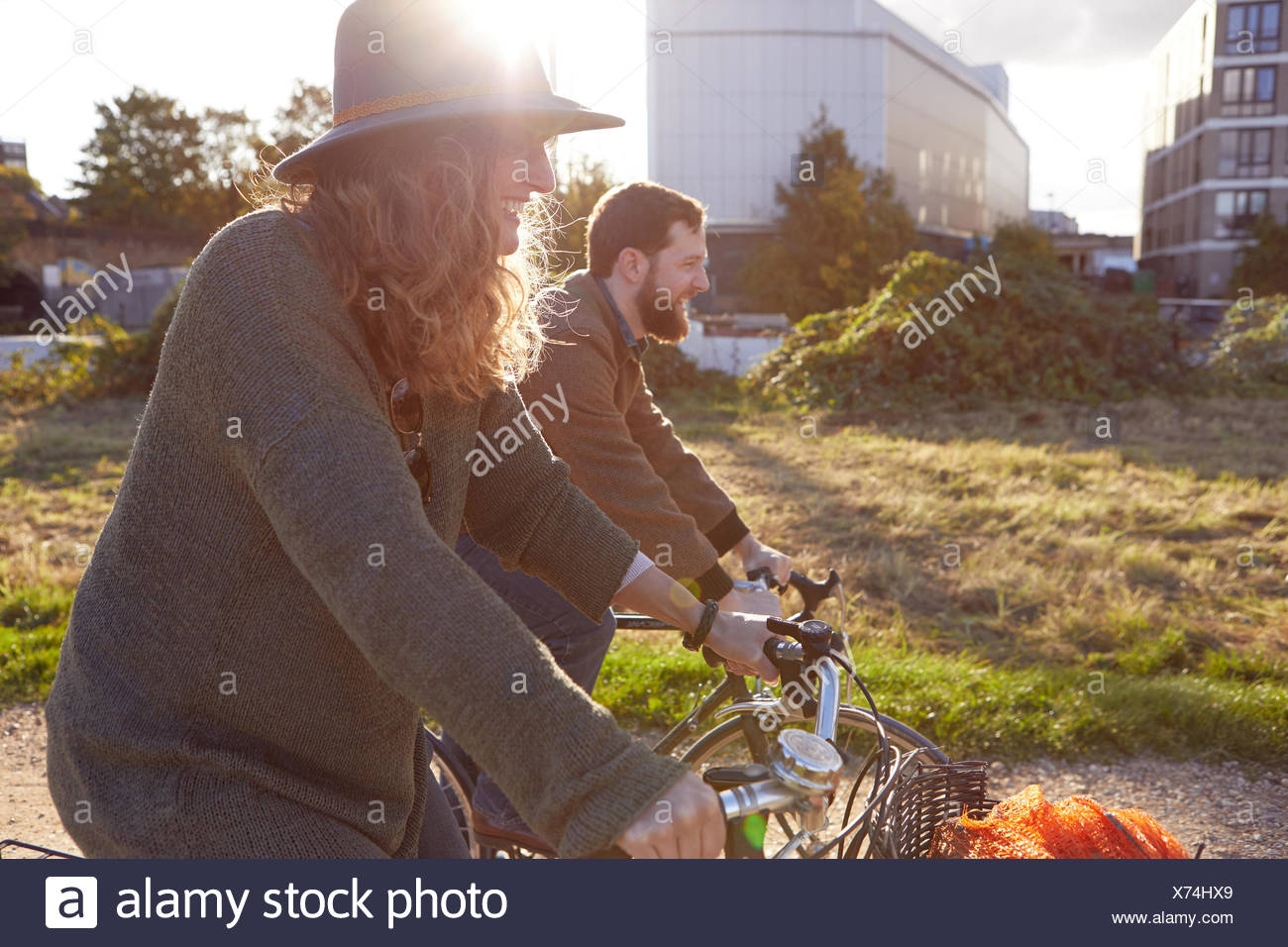 Couple enjoying cycling on marshes Stock Photo