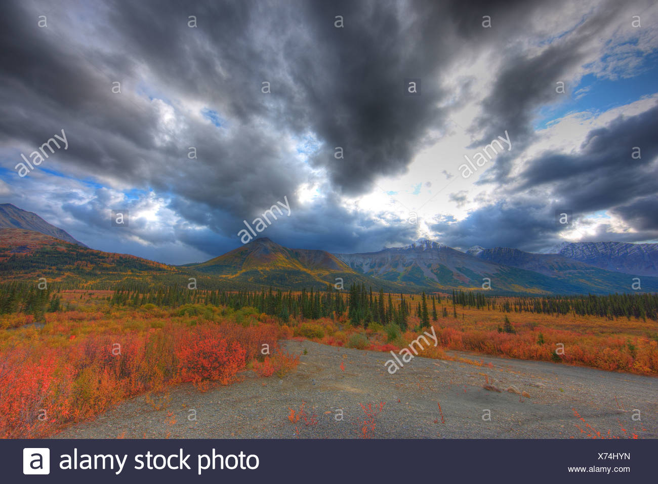 Clearing skies over a storm along the North Canol Road, Yukon. - Stock Image