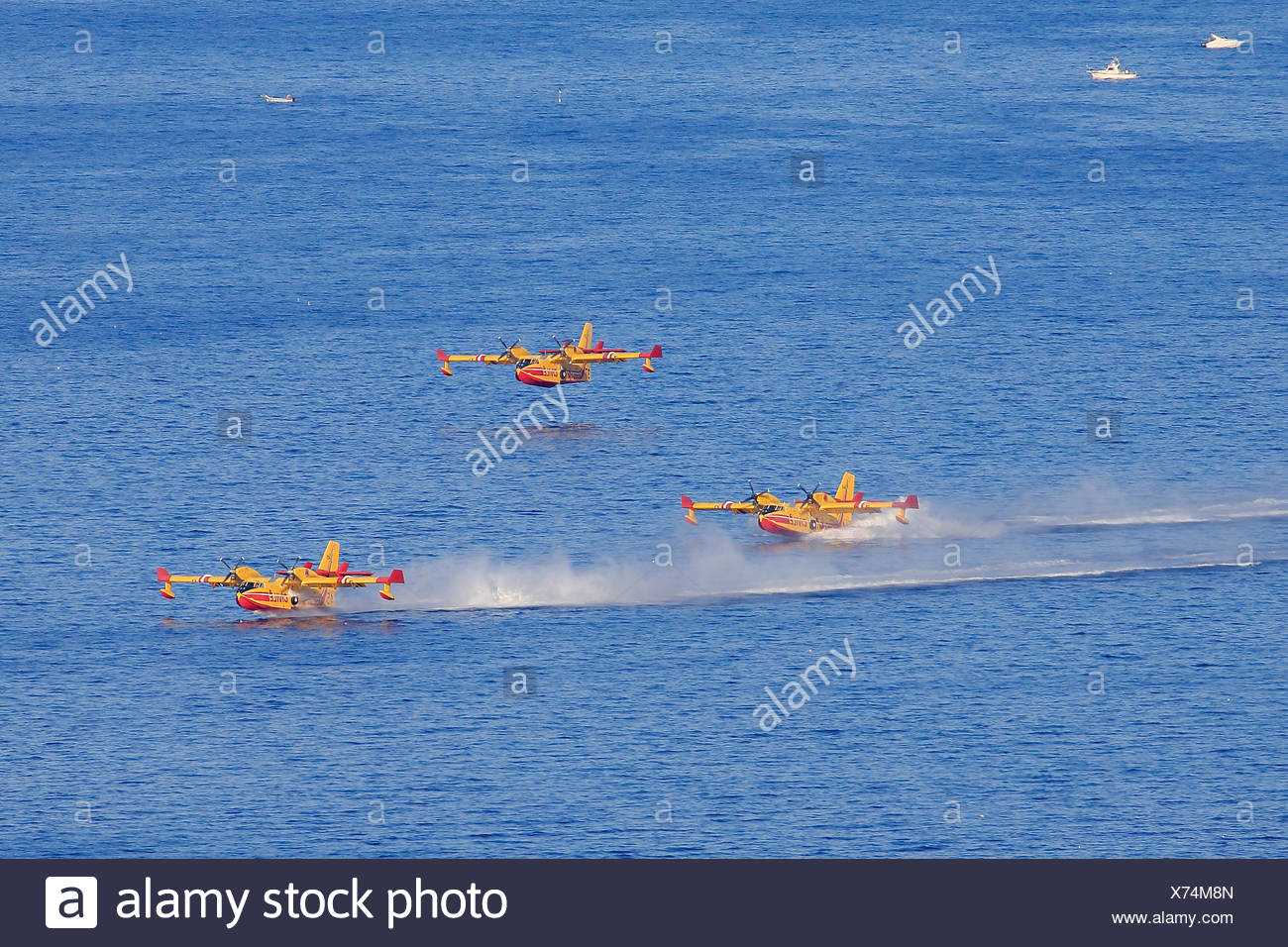 Firefighting aircraft Canadair CL 415, French Sécurité Civile, filling with seawater to extinguish forest fires - Stock Image