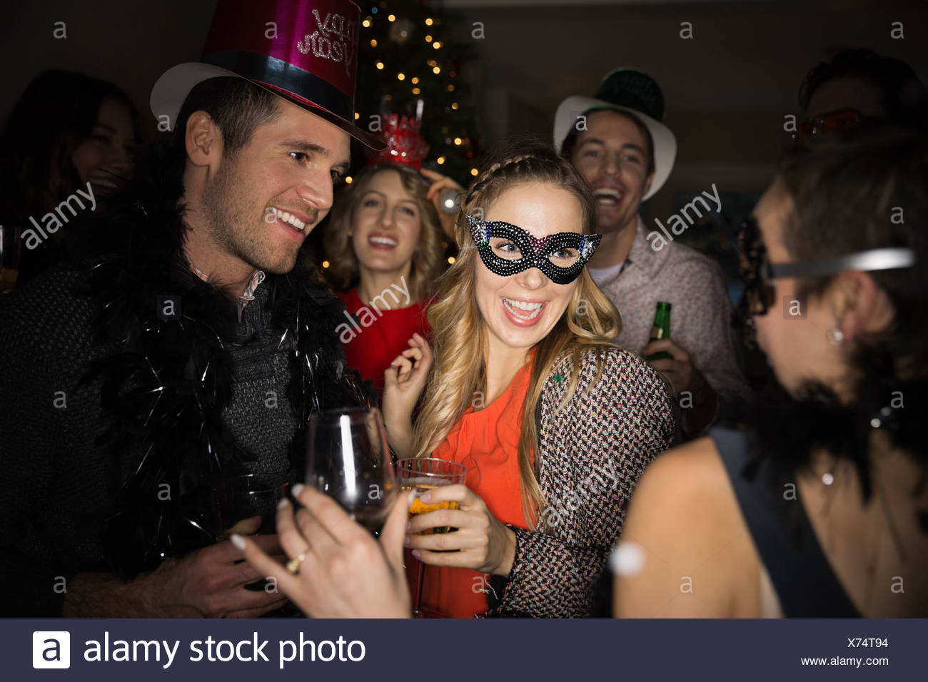 Friends enjoying New Years Eve party - Stock Image
