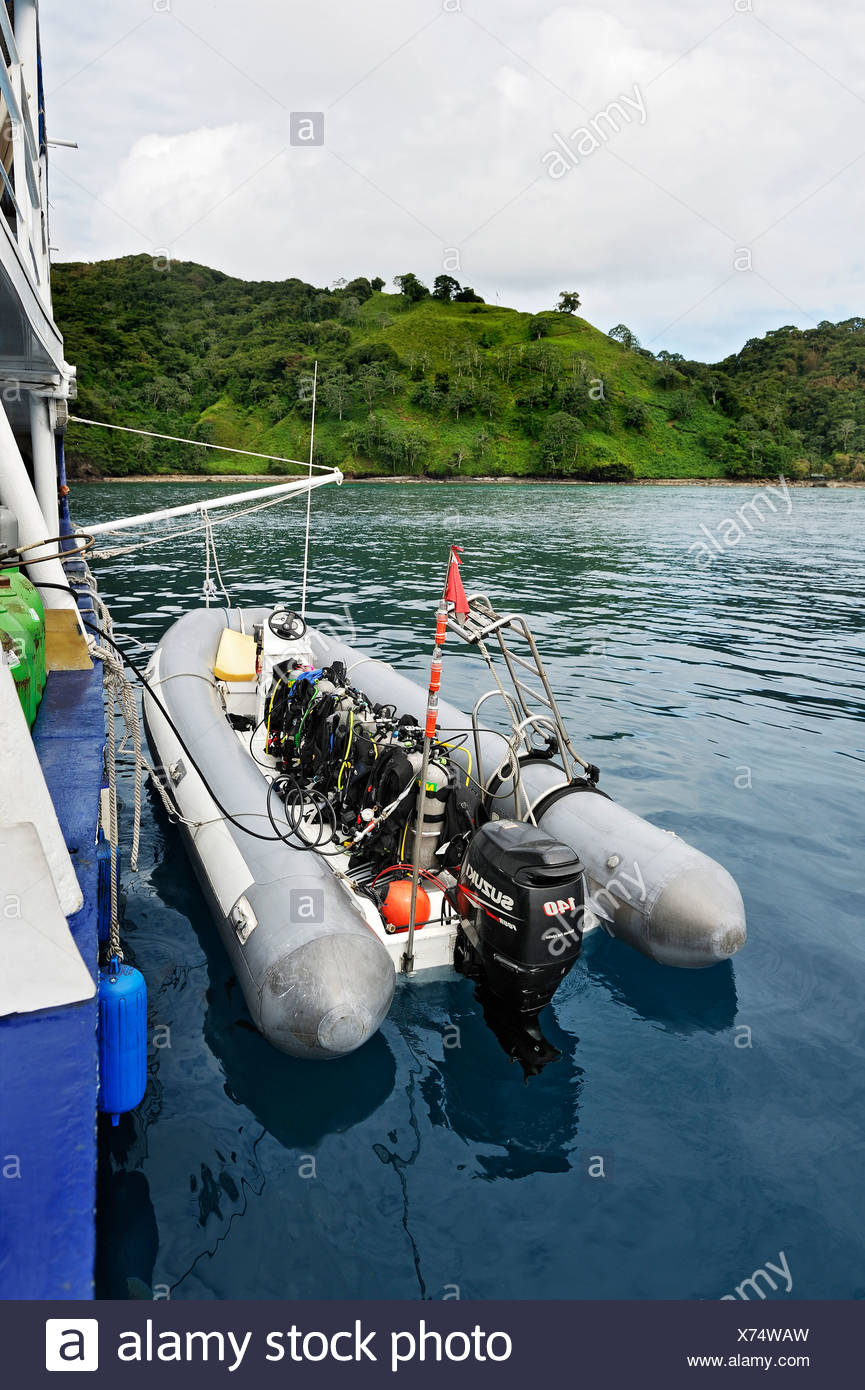 Dinghy and air tanks at the ship Okeanoss-Aggressor, Cocos Island, Costa Rica, Central America - Stock Image