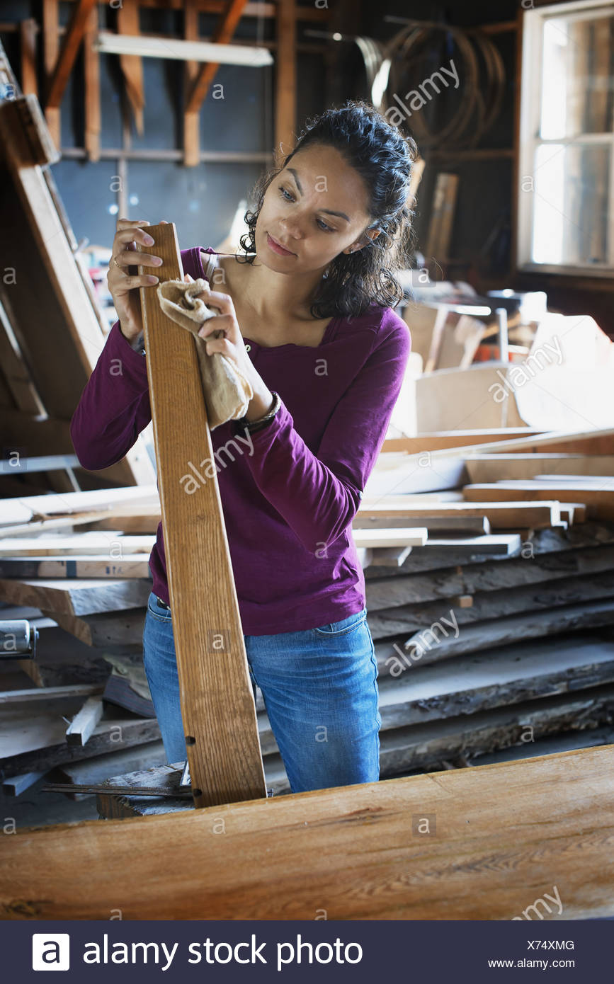 Woodstock New York USA woman working with reclaimed timber woodwork - Stock Image