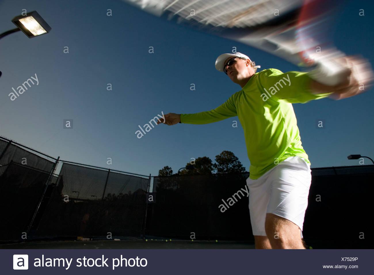 Tennis player hitting a backhand - Stock Image
