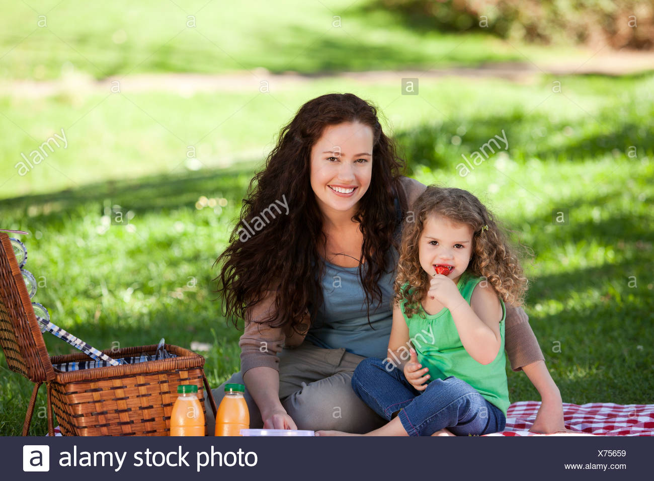 Mother and her daughter picnicking - Stock Image
