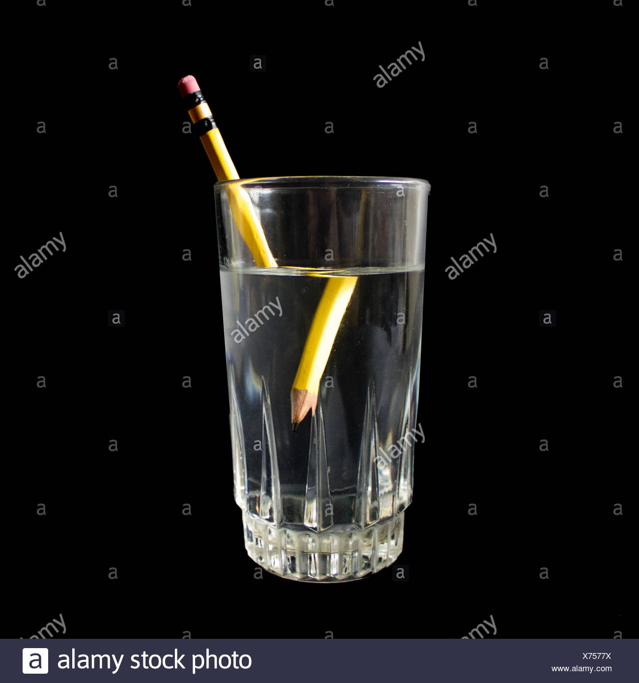 Distorted Pencil In A Glass Of Water - Stock Image