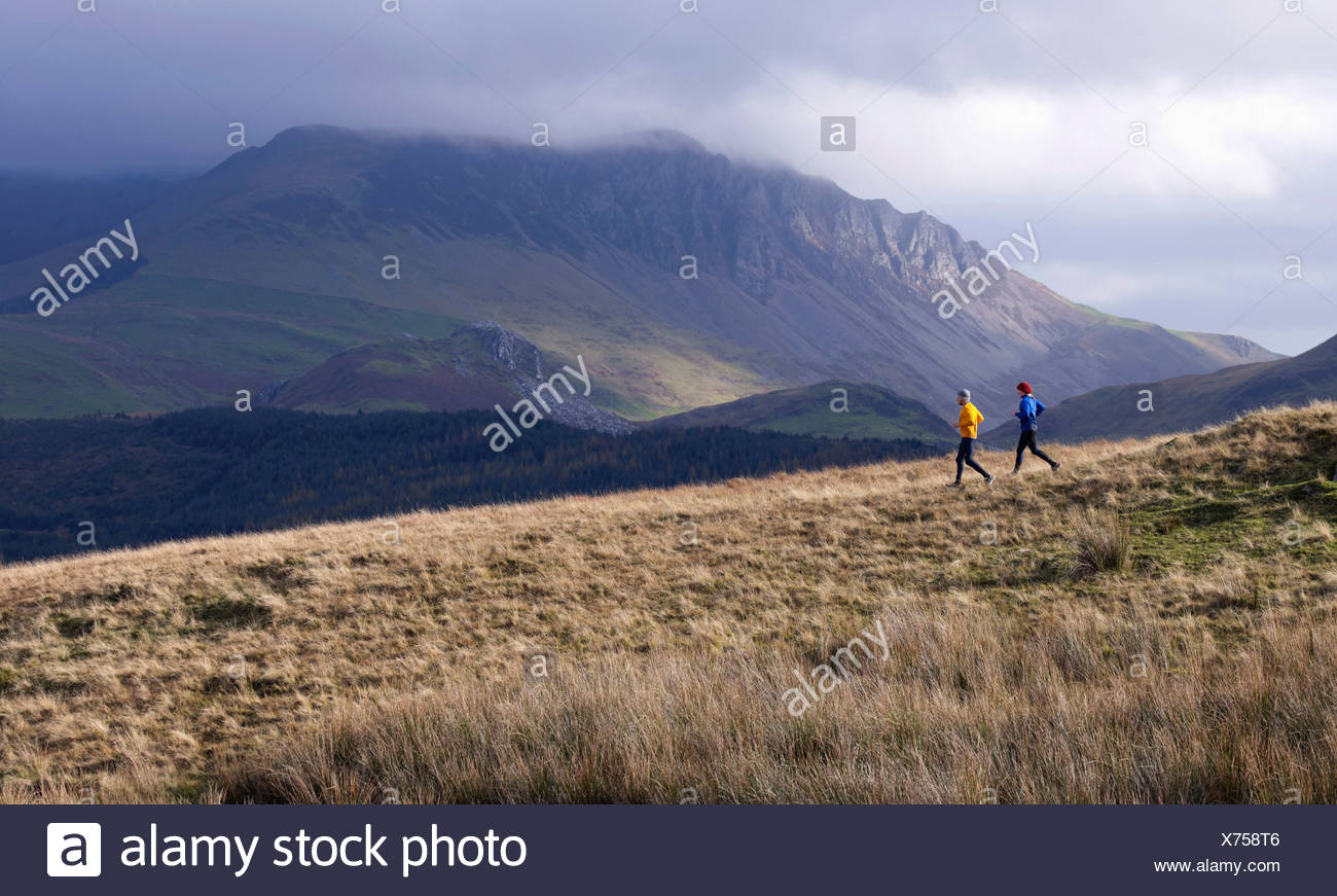 Couple running. - Stock Image