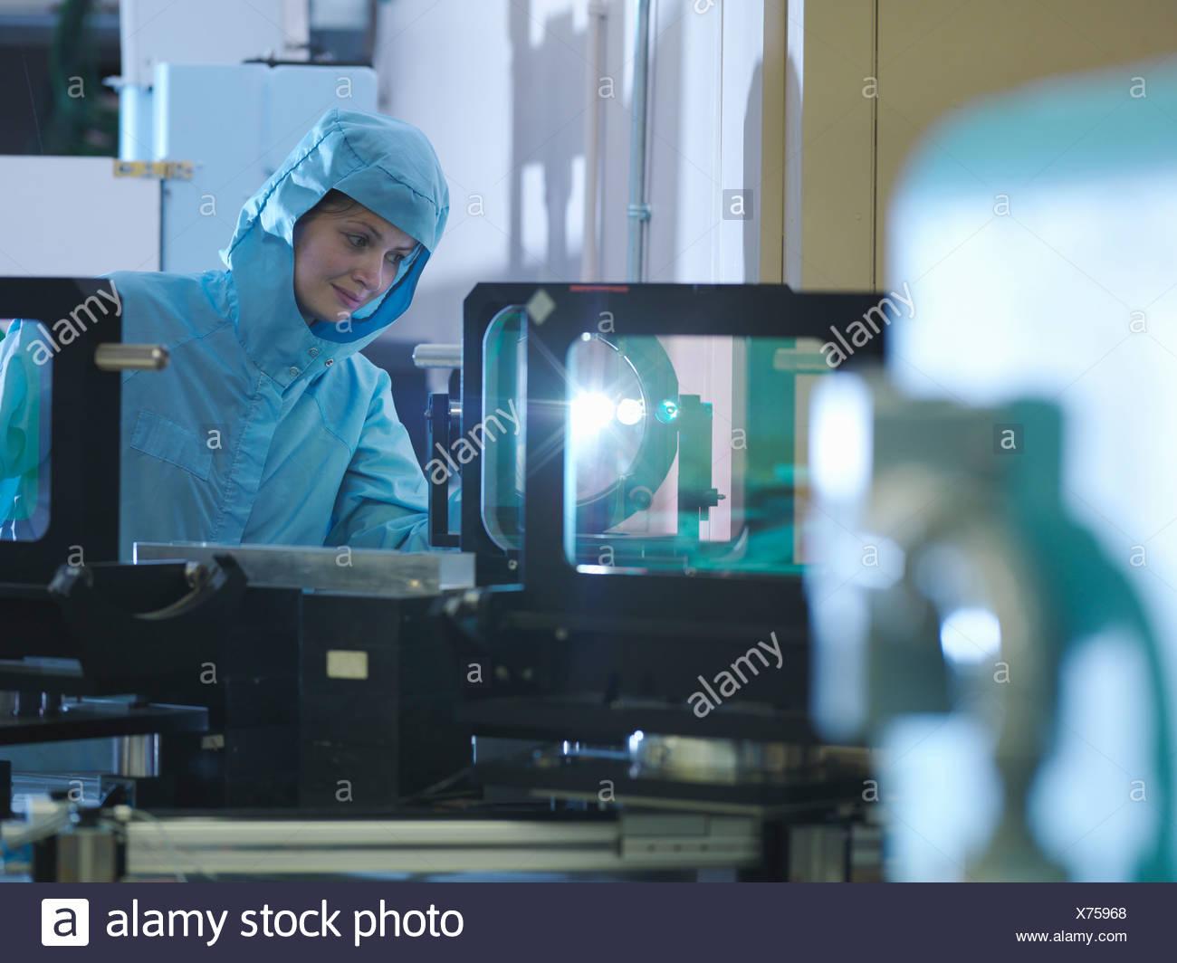 Scientist checking laser filter - Stock Image