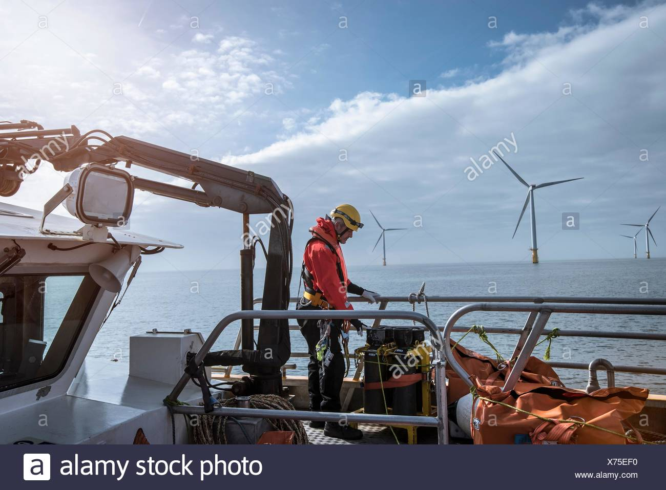 Engineer on deck of service boat at offshore windfarm Stock Photo