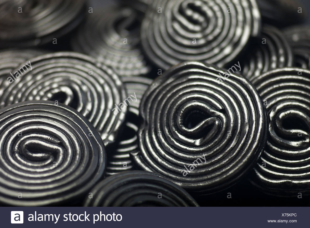 Detail of Liquorice snails. - Stock Image