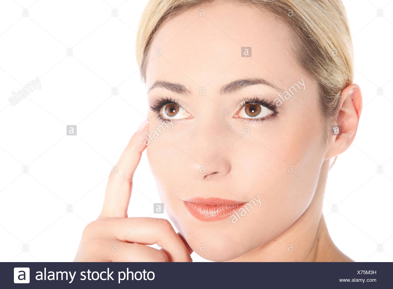 Portrait of Thinking Young Blonde Woman - Stock Image