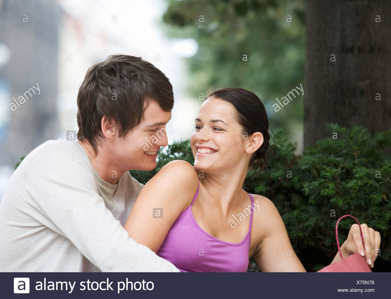 A young couple looking at their purchases - Stock Image